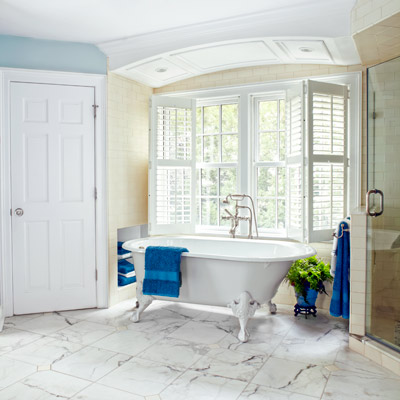 tub alcove with paneled ceiling with recessed lights, marble floor 