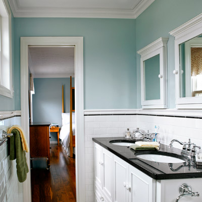 narrow small bathroom after remodel with his-and-hers sinks, blue walls