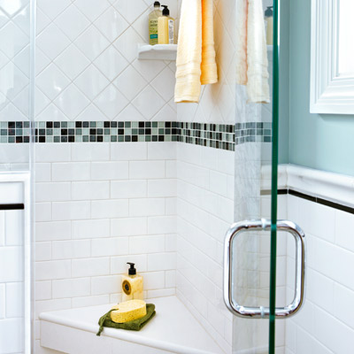 narrow small bathroom after remodel with shower with corner seat