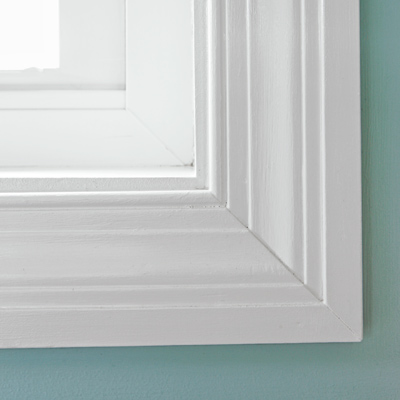 narrow small bathroom after remodel with custom windows with DIY casings