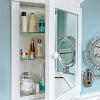 narrow small bathroom after remodel with custom medicine cabinets built and designed by the homeowner