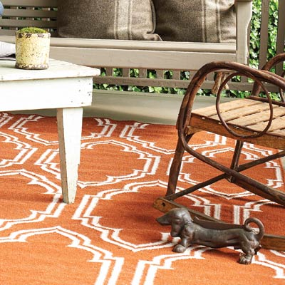 an area rug for a porch and rocking chair