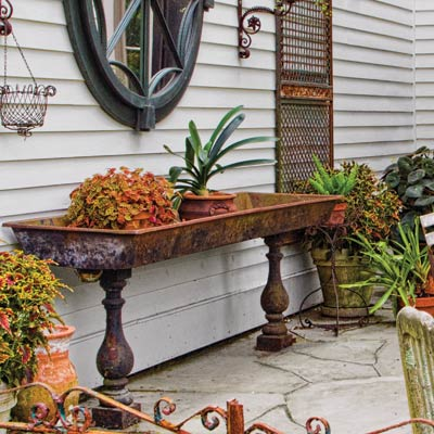 a patio with planters