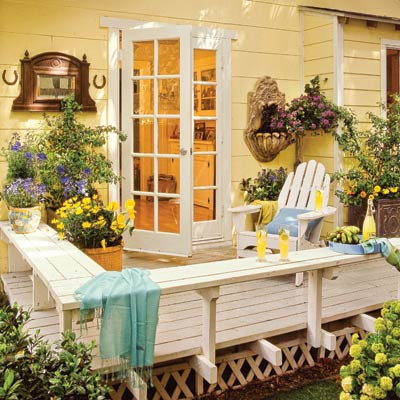 a deck with benches, planters and outdoor decorative ornaments