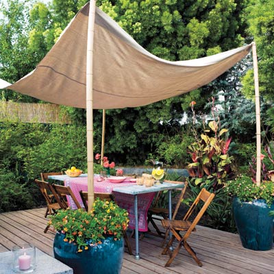 a deck with a canvas canopy