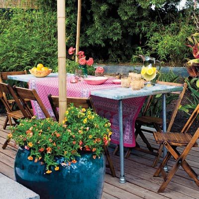 a deck with an outdoor dining table