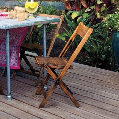 a deck with wooden folding chairs