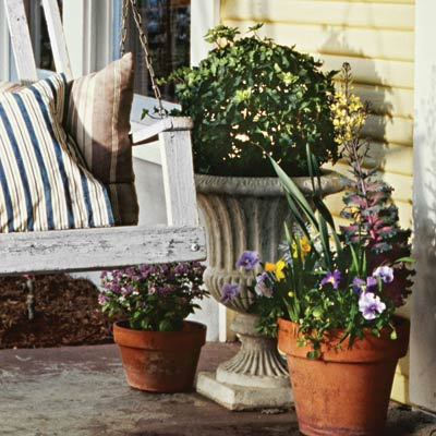 a porch with a classic urn planter