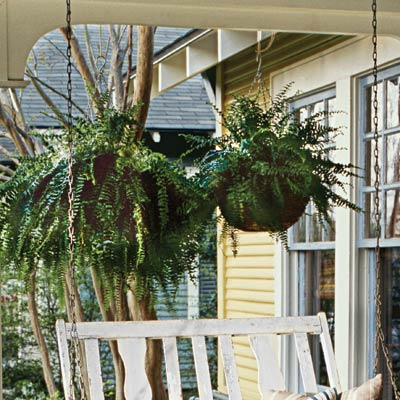 a porch with hanging basket planters