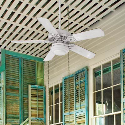 a porch with a ceiling fan
