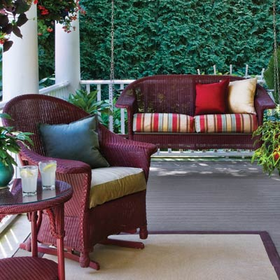 a porch with color-coordinated outdoor furniture