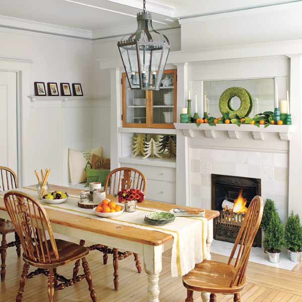 Christmas decorated dining room with lantern-style overhead light