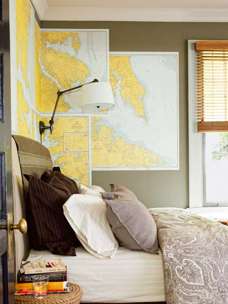 maps used as wall art in bedroom