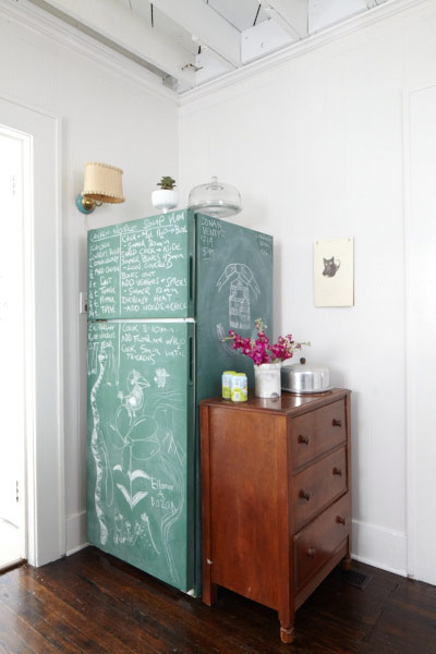 kitchen with fridge covered in chalkboard paint