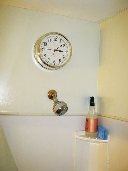 electric clock installed above a working shower head in a working shower in the this old house Home Inspection Nightmares XXVIII gallery