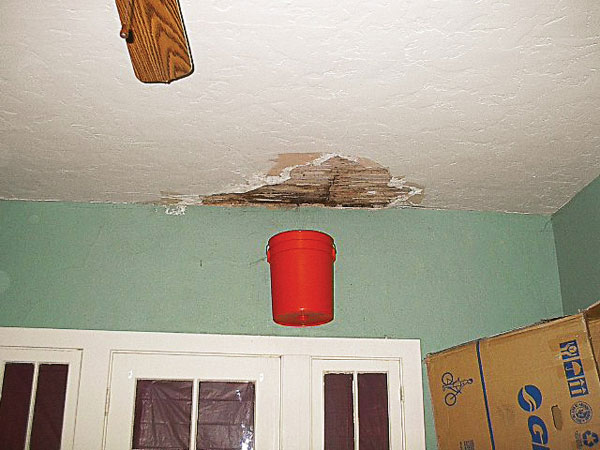 bucket hanging on a wall under a roof leak in the this old house Home Inspection Nightmares XXVIII gallery