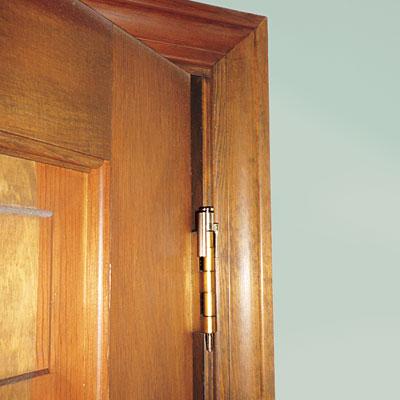 tool identified as a hinge-mounted door-friendly doorstop