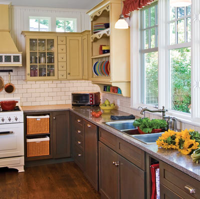colorful kitchen with 1920s details like subway tile, wood floor and beadboard ceiling