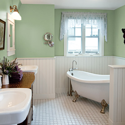 master bath with green walls, claw foot bathtub, white tile floor