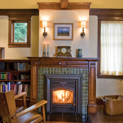 fireplace with mahogany mantel and ceramic tile