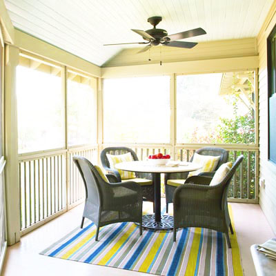 table and chairs in screen-in porch