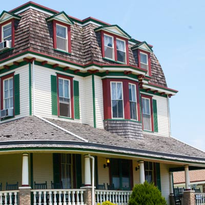 white home with green and red trim