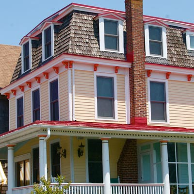 yellow house with red-orange trim