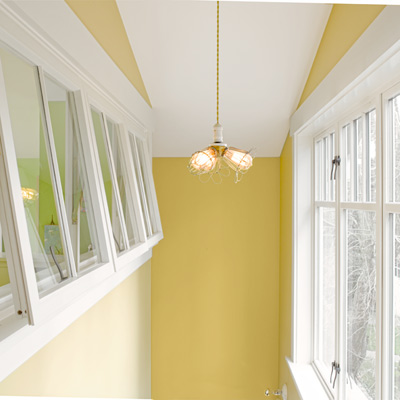 1918 craftsman bungalow after remodel yellow stairwell with awning-style interior windows
