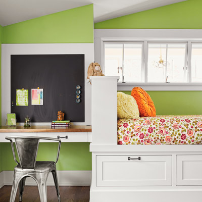 1918 craftsman bungalow after remodel child's bedroom with sloped ceiling, green walls and built-in desk and bed