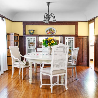 bungalow house living space with original built-ins, wainsocting, cove ceilings