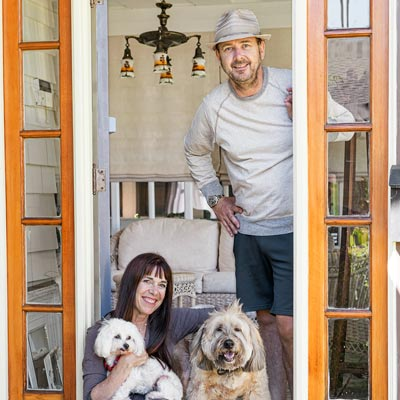 bungalow house homeowners Erin Donovan and Chris Long with two dogs