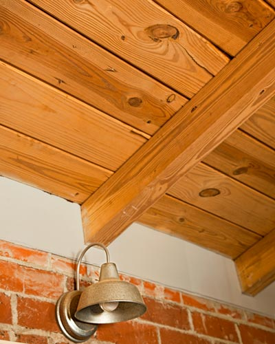 barn light sconce and wood-plant ceiling in open kitchen in cottage whole house remodel