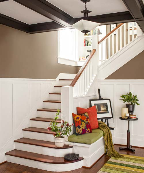 foyer of remodeled Craftsman with stairway, wainscoting and box-beam ceiling, oak floors