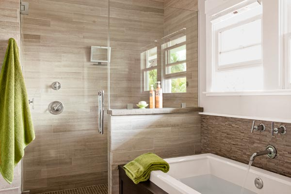 master bath of remodeled Craftsman with limestone tile walls