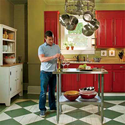 painted floor Shaker-style cabinets cottage-style kitchen and green walls