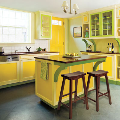 bold colors in yellow and green shades of equal intensity add life to this vibrant kitchen