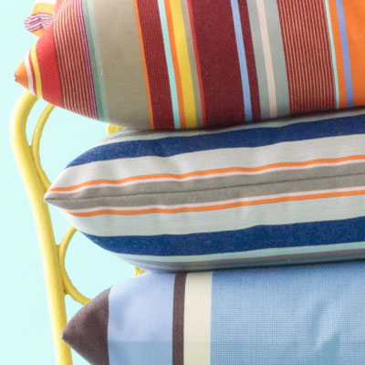 blue, orange, white and gray-striped pillow