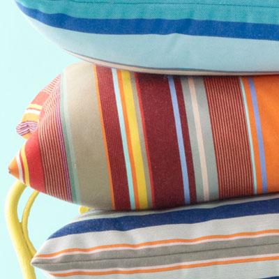 orange, blue, red, gray and yellow-striped pillow