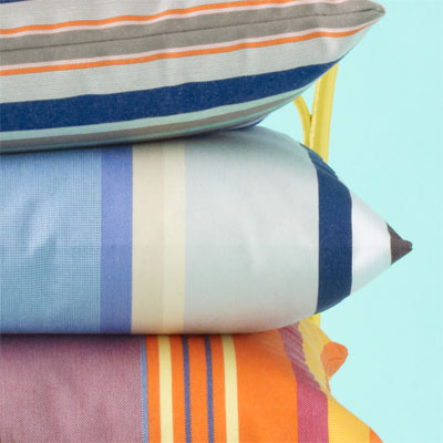 blue, beige, white and gray-striped pillow