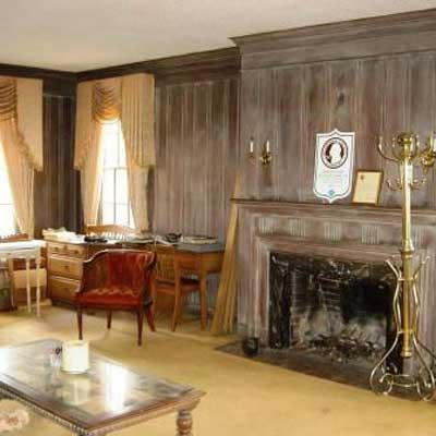 Wood Paneling Is Left Natural: Before from Best Living Spaces Before and Afters 2012