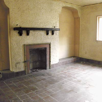 room with a tile floor and stucco walls