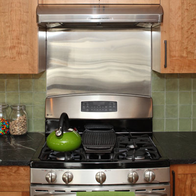 metallic range hood in a kitchen