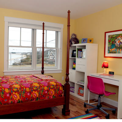 girl's bedroom in above-the-garage addition in remodeled Cape Cod
