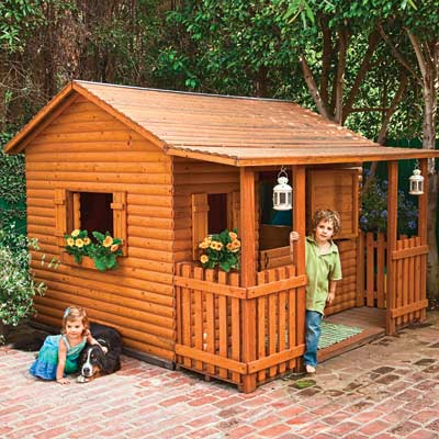 children's log cabin playhouse on brick patio