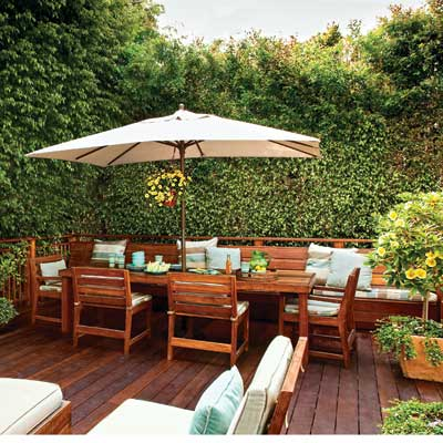 backyard wood deck with dining area, built-in banquette, square market umbrella