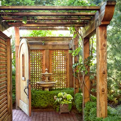 arched wood garden gate brick path 