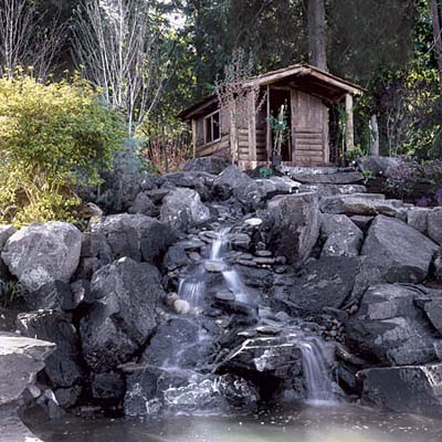 waterfall and cabin in Seattle front yard