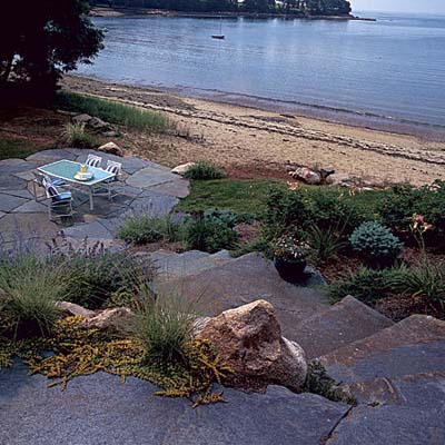 stone patio and stairs on inlet in Massachusetts