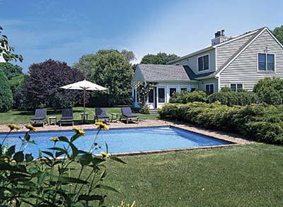 backyard swimming pool and screened porch