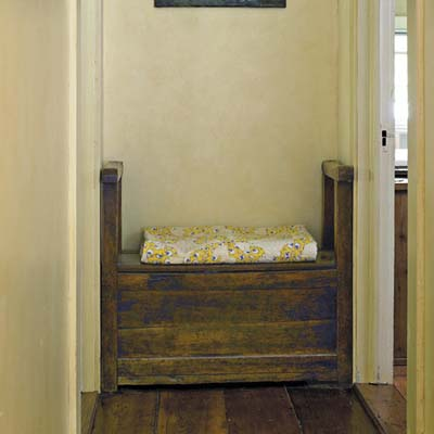 18th century bench, with storage space inside,  in the hallway